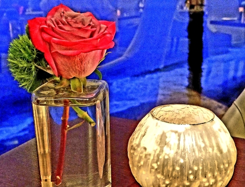 red rose candle sea